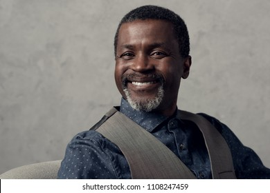 portrait of smiling mature african american man in waistcoat