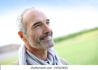 Portrait of smiling mature handsome guy