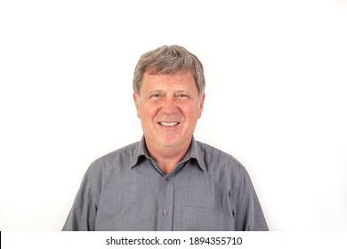 portrait of smiling mature man with grey polo shirt