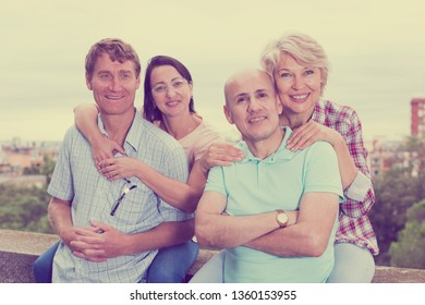 Portrait of smiling mature people outdoors together in the park
