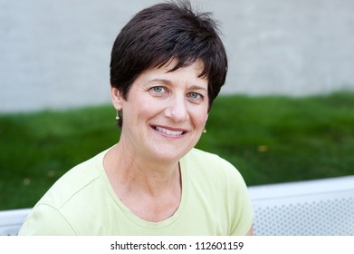portrait of a smiling mature woman taken outside