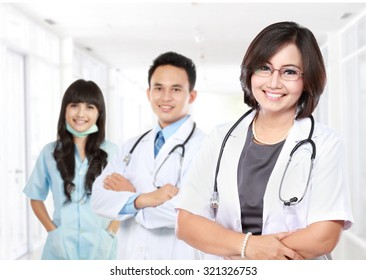 portrait of Smiling medical doctor with stethoscope with her staff.
