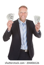 Portrait of smiling mid adult businessman holding bank notes over white background