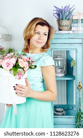 Portrait of smiling mid adult woman with basket or roses