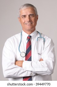 Portrait of Smiling Middle Aged  Doctor with Stethoscope and arms crossed