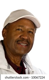 A portrait of a smiling, middle-aged black golfer.