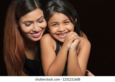 Portrait of smiling mother and daughter