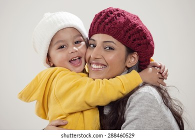 Portrait of smiling mother and son embracing