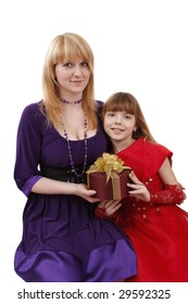Portrait of a smiling mother and teenage daughter. Woman and girl are holding the present. Mother and daughter want to give dad the gift.
