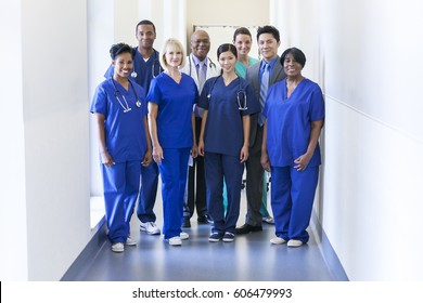 Portrait smiling multi ethnic medical team for specialist patient care provision in modern hospital facility