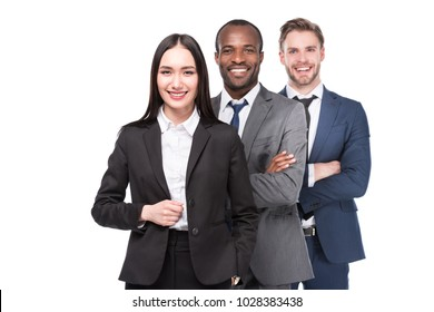 portrait of smiling multicultural young business people in suits isolated on white  background