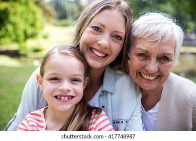 Portrait of smiling multi-generation family in the park