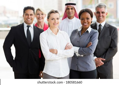 portrait of smiling multiracial business team in office