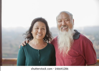 Portrait Of Smiling Old Couple In Jing Shan Park