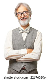 Portrait of smiling old fashioned senior man with gray beard, glasses and bowtie with hands folded isolated on white background