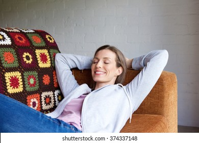 Portrait of a smiling older woman relaxing at home