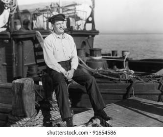 Portrait of smiling on dock near boat