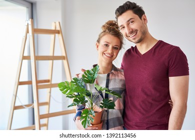 Portrait of smiling owner moving in new flat