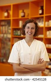 Portrait of a smiling pharmacist in pharmacy