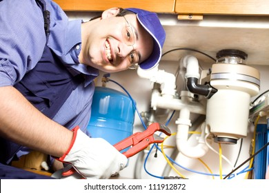 Portrait of a smiling plumber at work