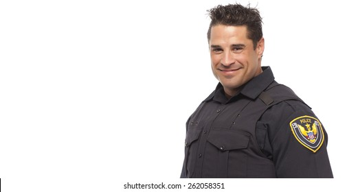 Portrait of smiling police man standing against white background