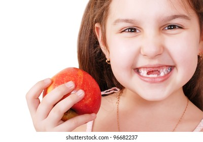Portrait of Smiling pretty little girl without teeth with red apple in hand