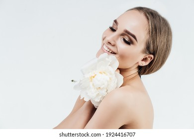 Portrait of a smiling and radiant woman, she has a beautiful look and healthy skin, a place for text. Beauty salon and spa treatments. Classification.