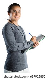 Portrait of smiling rugby coach writing on clipboard while standing against white background