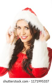 Portrait of smiling santa woman touching her hat.