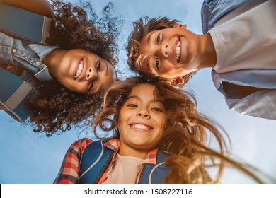 Portrait of smiling school kids standing in cecrle at school yard with look in camera - Shutterstock ID 1508727116