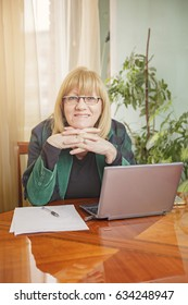 Portrait of a smiling senior blonde business woman