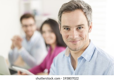 Portrait of a smiling senior businessman  in meeting