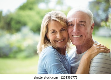 Portrait of smiling senior couple embracing outdoors
