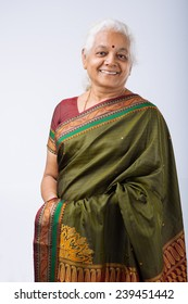 Portrait of smiling senior Indian woman in traditional costume