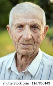 portrait of smiling senior man close-up