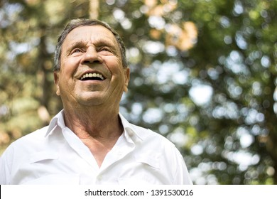 Portrait of a smiling senior man in Nature