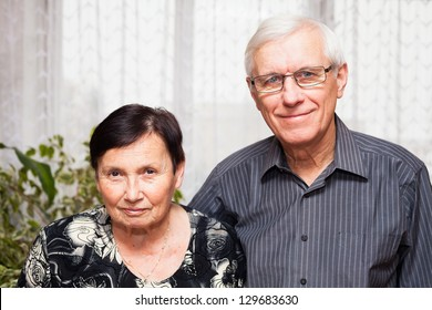 Portrait of smiling senior man and woman.