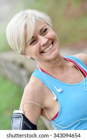 Portrait of smiling senior woman after exercising
