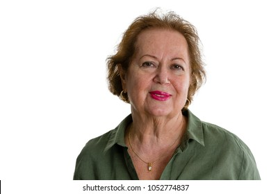 Portrait of smiling senior woman against white background