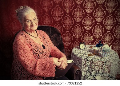 Portrait of a smiling senior woman having a rest at home.
