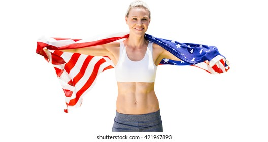 Portrait of smiling sportswoman posing with an american flag