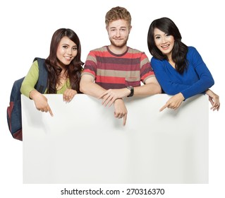 A portrait of smiling students holding blank white banner isolated on white background