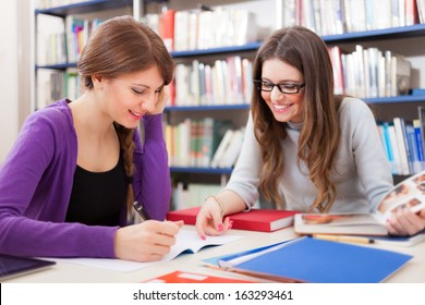 Portrait of smiling students at work in a library