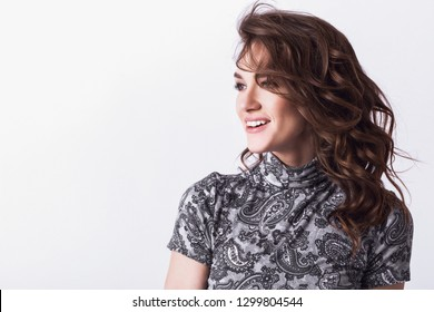 Portrait of a smiling studio woman on a white background. Lifestyle.