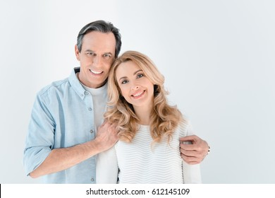 portrait of smiling stylish mature man and woman isolated on white