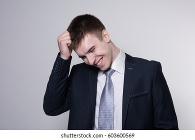 Portrait of smiling successful businessman. Business Head Isolated on gray background