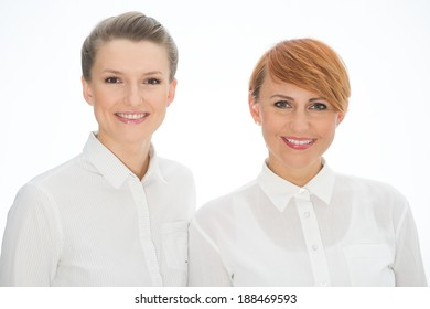 Portrait of a smiling and successful middle aged business executives and workers - team and customer service women