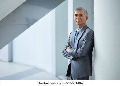 Portrait of smiling Taiwan businessman looking at camera
