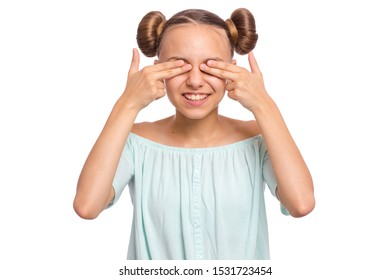 Portrait of smiling teen girl with hands on face covering eyes for surprise. Positive teenager close eyes with fingers. Happy caucasian child isolated on white background. See no evil concept.