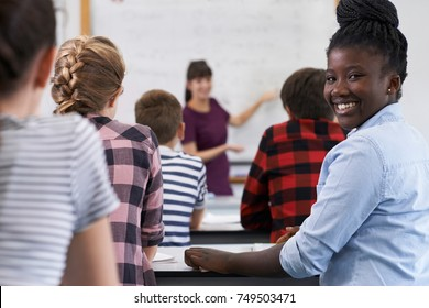 Portrait Of Smiling Teenage Pupil In Class